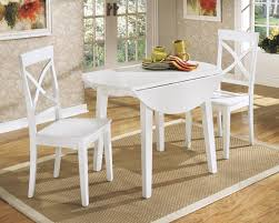 Round kitchen table with leaf Foldable Round White Painted Wooden And Two Chairs Square Rug Stylish Wallpaper On Wall With Frames Round White Table Etsy White Round Kitchen Table And Chairs Design Homesfeed