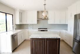 kitchen remodel with quartz countertops and a honed marble island