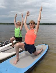 Troy woman, 67, leads unique fitness classes on paddleboards at Stony Creek  | Vitality Senior Living | macombdaily.com