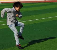 korean children playing soccer photo essay a korean boy following through on a kick he had just made