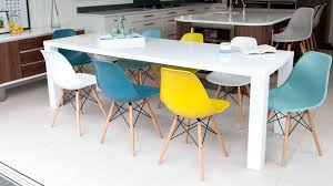 modern white gloss extending table and eames chairs large white gloss extending table and colourful dining chairs