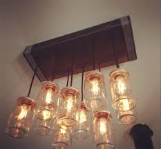 a reclaimed wood chandelier that includes 24 x 10 wood canopy your choice of dark or light stain or paint 8 mason jar lights