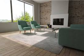 white cowhide patchwork rug in squares with border in sunny living room