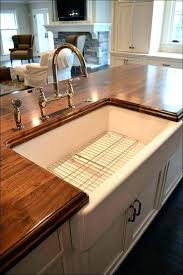 farmhouse sink with drainboard cabinet legs clarion