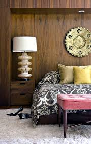 ethnic flair let the wood wall paneling in naturally and modern look