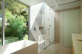 cool simple bathroom with frosted glass shower idea beside freestanding bathtub