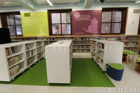 cantilever carts on wheels in a library s childrens book area