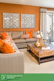bedroom, Orange Walls Patterned Artwork And Light Carpets Add To The  Chocolate Brown Living Room ...