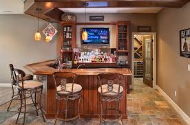... Basement bar complete with a wine cellar [Design: Build Cincinnati of  Coldwell Banker]