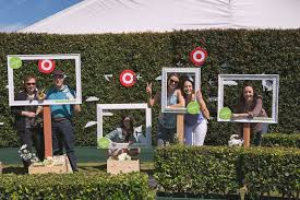 guests pose in picture frames at the target made to matter event in san francisco