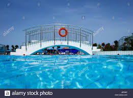 underwater water park. Half Underwater Shot, Clear Turquoise Water On Swimming Pool And Foothbridge. Park