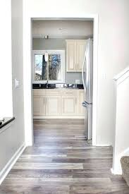 light grey walls white trim light grey walls light grey walls grey walls white trim light wood floors light grey bedroom with white trim