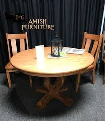 new stylish pedestal table made from solid cherry wood with a beautiful light stain color