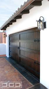 custom architectural spanish garage door in solid mahogany wood with decorative iron hardware