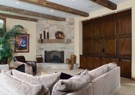 corner stone fireplace family room traditional with beams built ins stone image by orren pickell building group