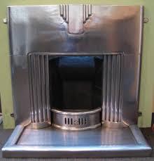 art deco gietijzeren openhaard met metalen schouw cast iron fireplace with metal mantel