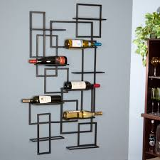 Interior. mounted black metal Wine Racks with rectangular black wine bottle  placed on grey wall