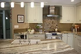leathered brown fantasy hard marble countertop with off white cabinets picture