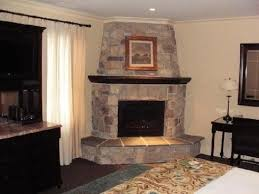 Corner fireplace stacked stone