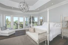 traditional master bedroom with french doors chandelier in vero inside foucault orb