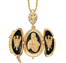 beautiful egg pendant and necklace with 50 austrian crystals and black enamel gold plated very good condition like new