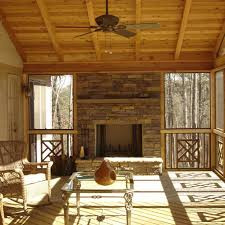 this beautiful screened in porch is the perfect place to enjoy the outdoors all year round