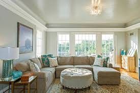 baroque round ottoman coffee table in living room farmhouse with next to paint for hardwood floors alongside huge sectional and bubble glass