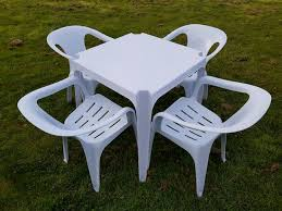 plastic garden table and 4 chairs off 71
