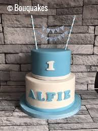 Two Tier Baby Blue And White First Birthday Cake Bouquakes