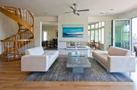 concrete coffee table living room tropical with area rug beach house beach house living room tropical family room