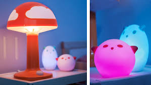 Close-up of SKOJIG red children's lamp and SPKA LED night light in red and