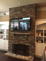 hdtv mounting on stone fireplace