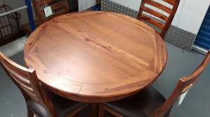 round dark wood extending dining table 4 designer kember chairs
