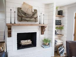 rustic white fireplace with wooden mantel