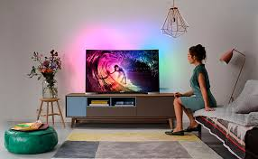 samsung curved tv in living room. philips has just revealed a new lineup of 4k tvs, along with way to actually play something on them. the standout model is 55-inch curved 8900 samsung tv in living room