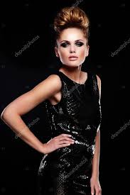high fashion look glamor portrait of beautiful y stylish caucasian young woman female model in black dress with bright makeup and hairstyle photo by