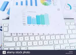 Picture Of Bar Graph Paper And Keyboard Stock Photo