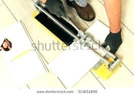 cutting ceramic tile with dremel tile cutter cutting ceramic tile laying ceramic tiles tiler cuts tile cutting ceramic tile with dremel