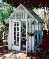 a great way of reusing windows and doors as a greenhouse