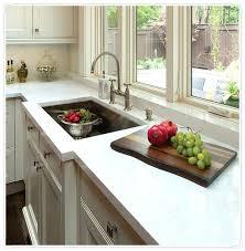 kitchen quartz vs granite pros and cons grey with white sparkle countertops home improvement depot cabinets