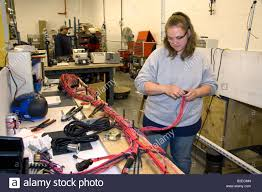 female worker wiring harness assembly at spartan motors truck female worker wiring harness assembly at spartan motors truck chassis manufacturing in charlotte michigan