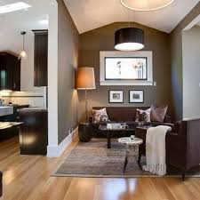 these light hardwood floors contrast dark brown furniture the light lshade and cream throw are nice accessories