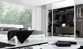 view in gallery sleek and stylish bedroom in black and white with a walk in closet