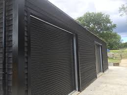 exterior timber cladding for sheds. detail of one our steel framed buildings showing black shiplap timber cladding exterior for sheds