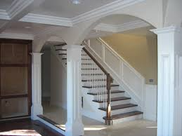 Molding For Living Room Living Room Boasts Of Arches Crown Molding And Pillars Pictures