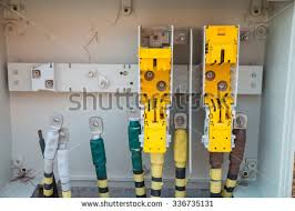 electrical wire in conduit on construction site photos detail · detail take of an unfinished fuse box on a construction site 336735131