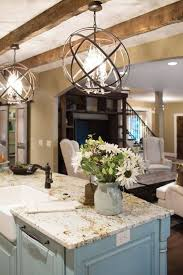 ball shaped iron affordable chandelier for traditional kitchen ideas with soft blue island using marble topped chandelier over