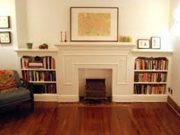 great faux fireplace white mantel also custom target bookshelves cabinet also wooden floors at living room