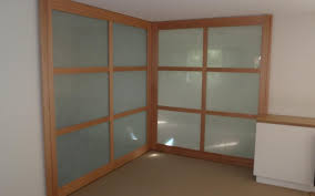 solid timber sliding doors with frosted glass panels