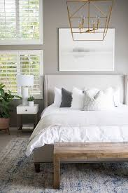 bedroom rug placement should offer plenty of leeway along the sides of the bed like